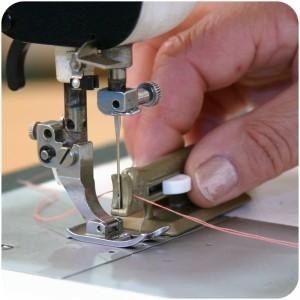 enhebrador maquina coser