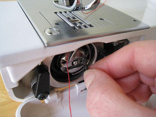 enrollar bobina maquina de coser